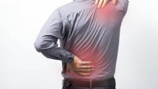 What are degenerative diseases of the spine and how are they treated?